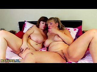 A chubby lesbian teen and a mature lady pleasuring each other