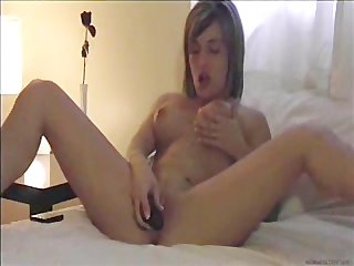 Amateur girl strips and masturbates