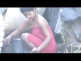 Indian hot village girl bathing outside