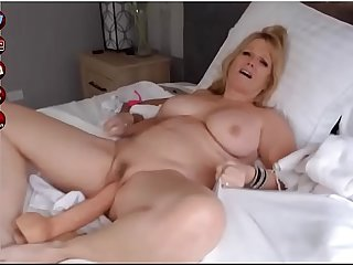 Blonde milf fucking dildo on webcam show