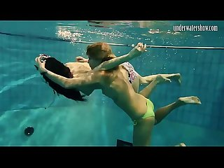 Girls Andrea and Monica stripping one another underwater