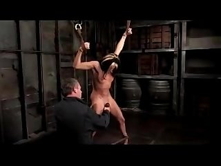 Girl tied legs and arms hanging whipped tickled fingered stimulated with vibrator in the dungeon